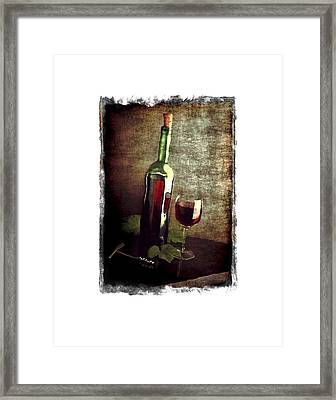 Tipsy Bottle Framed Print by Roger Winkler