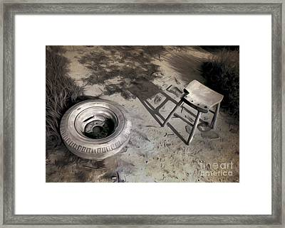 Tire And Stool Framed Print by Gregory Dyer