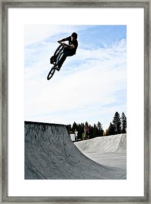 Tire Grab Framed Print by Joel Loftus