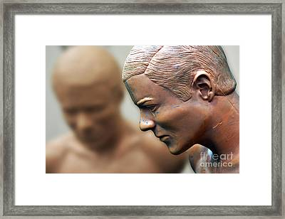 Tired Of Being Beat Up Framed Print by Rick Bravo