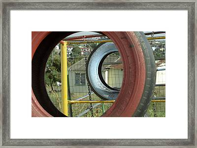 Tires In An Orphanage Framed Print