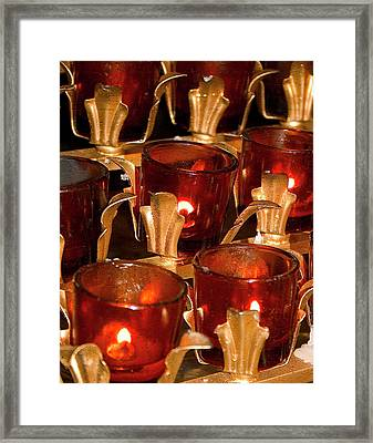 To Lite A Candle Framed Print