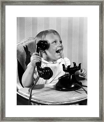 Toddler With Telephone Framed Print by Underwood Archives
