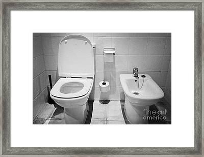Toilet And Bidet In A Hotel Room Salou Catalonia Spain Framed Print by Joe Fox