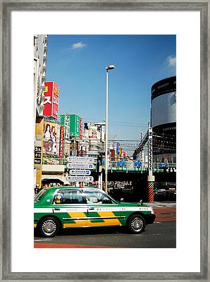 Tokyo Time Framed Print by Ruby And Wolf