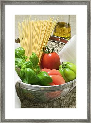 Tomatoes, Spaghetti And Basil In A Bowl Framed Print