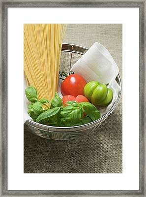 Tomatoes, Spaghetti And Basil In A Sieve Framed Print