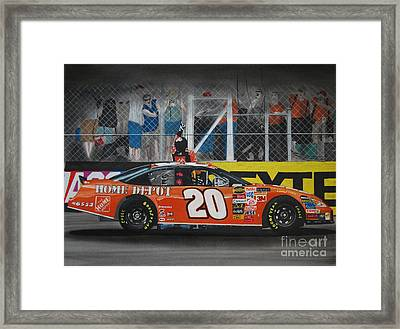 Tony Stewart Climbs For The Checkered Flag Framed Print by Paul Kuras