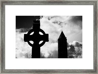 top of St Kevins Round Tower and celtic cross headstone at Glendalough monastic site county wicklow ireland Framed Print