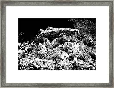 Top Of The Cliff Framed Print by John Rizzuto