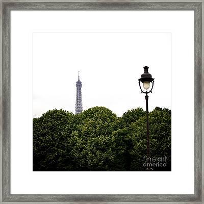 Top Of The Eiffel Tower And Street Lamp. Paris.france. Framed Print by Bernard Jaubert