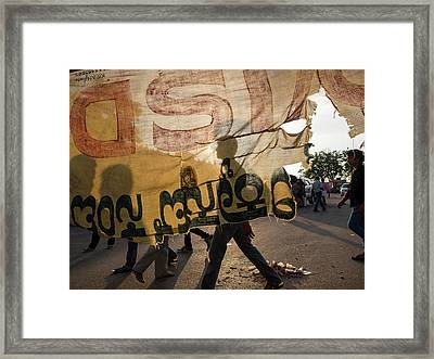 Torn Cloth Banner And Street Scene Framed Print