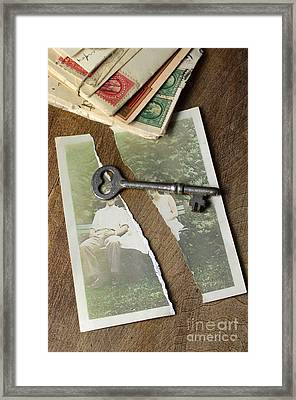 Torn Photograph With Key And Old Letters Framed Print by Jill Battaglia