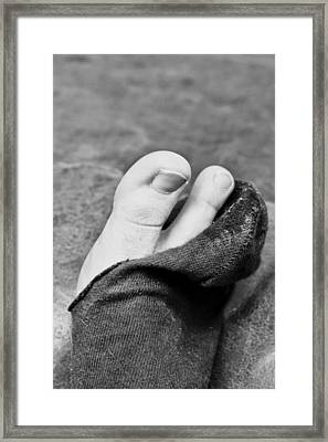 Torn Sock Framed Print