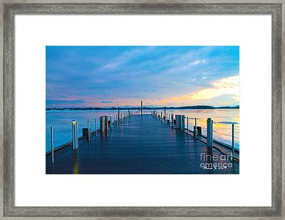 Framed Print featuring the photograph Toronto Pier During A Winter Sunset by Nina Silver