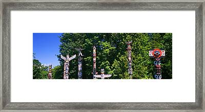Totem Poles In A A Park, Stanley Park Framed Print by Panoramic Images