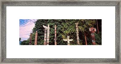 Totem Poles In A Park, Stanley Park Framed Print by Panoramic Images