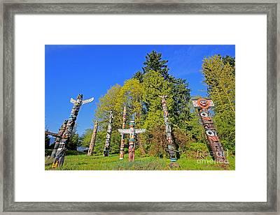 Totem Poles In Stanley Park Framed Print
