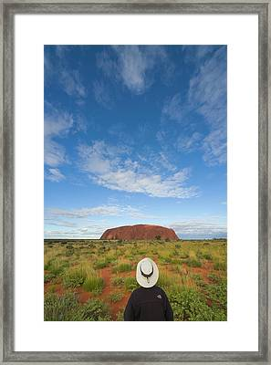 Tourist And Clouds At  Ayers Rock Framed Print by Yva Momatiuk John Eastcott
