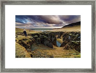 Tourist At Fjadrargljufur Canyon Framed Print by Anna Gorin