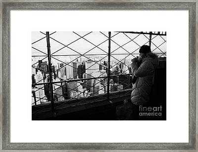 Tourist In Heavy Coat And Camera Looks At The View From Observation Deck 86th Floor Empire State  Framed Print