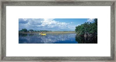 Tourist Kayaking In A Pond, Nine-mile Framed Print