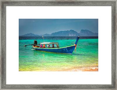 Tourist Longboat Framed Print by Adrian Evans