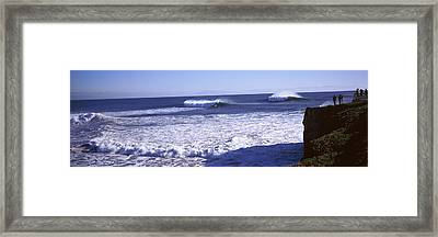 Tourist Looking At Waves In The Sea Framed Print by Panoramic Images