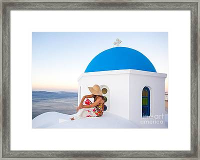 Tourist On Blue Domed Church In Santorini Greece Framed Print by Matteo Colombo