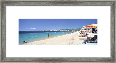 Tourist On The Beach, Porto Carras Framed Print by Panoramic Images