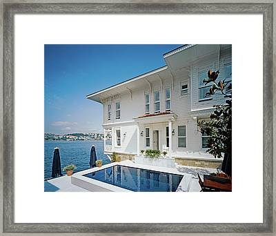 Tourist Resort By Water Framed Print by Erhard Pfeiffer