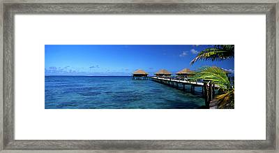Tourist Resort On A Pier At Dusk Framed Print by Panoramic Images