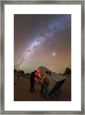 Tourist Using A Telescope Framed Print by Babak Tafreshi
