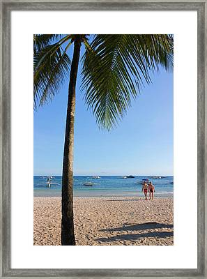 Tourists And Palm Tree On The Beach Framed Print by Keren Su