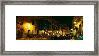 Tourists At A Sidewalk Cafe, Majorca Framed Print