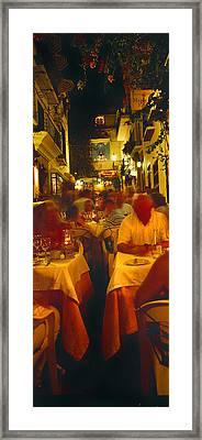 Tourists At A Sidewalk Cafe, Marbella Framed Print