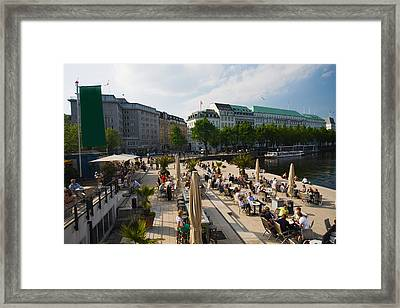 Tourists At A Sidewalk Cafe Framed Print