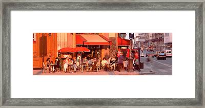 Tourists At A Sidewalk Cafe, Paris Framed Print by Panoramic Images