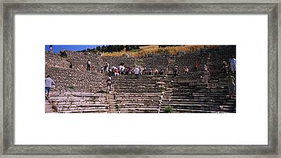 Tourists At Old Ruins Of An Framed Print by Panoramic Images