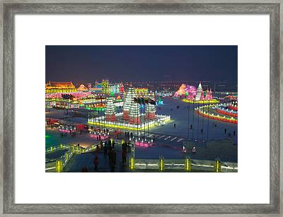 Tourists At The Harbin International Framed Print