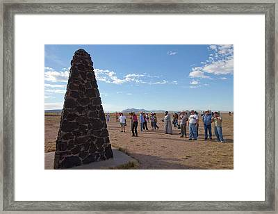 Tourists At Trinity Test Site Framed Print by Peter Menzel