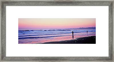 Tourists Fly-fishing On Beach Framed Print by Panoramic Images