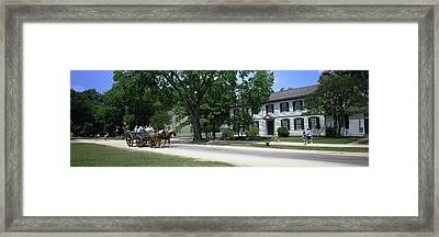Tourists In A Horsedrawn On The Road Framed Print