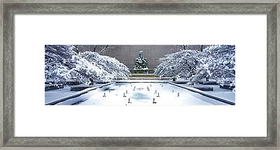 Tourists In Front Of A Fountain Framed Print