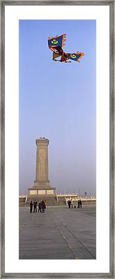 Tourists In Front Of A Monument Framed Print