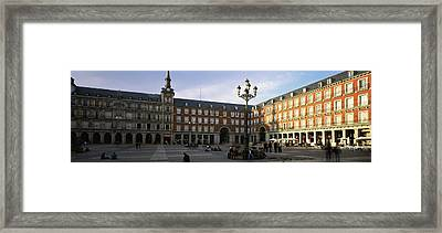 Tourists In The Courtyard Framed Print