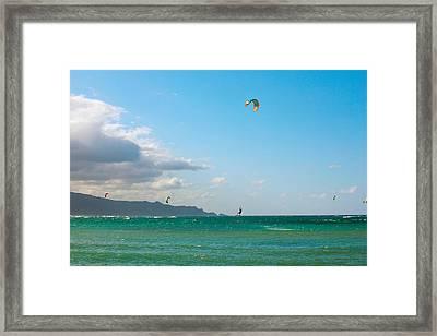 Tourists Kiteboarding In The Ocean Framed Print