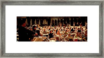 Tourists Listening To A Violinist At A Framed Print