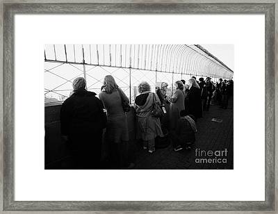 Tourists  Look At The View From Observation Deck Empire State Building Framed Print by Joe Fox