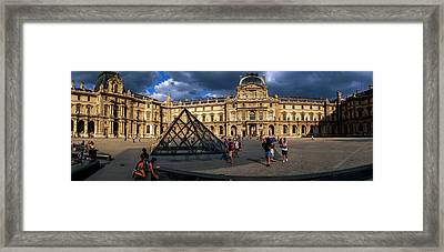 Tourists Near A Glass Pyramid At Musee Framed Print